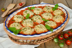 Roll out the dough with minced meat in vegetable sauce Stock Photography