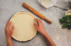 Roll out dough in pizza shape royalty free stock photography