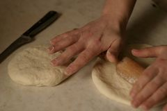 Cooking and rolling bread for tea. stock photo