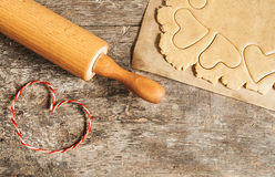 Roll out the dough to cut out heart shapes Stock Image