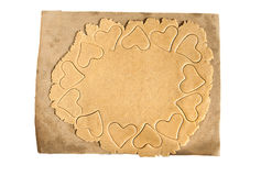 Roll out the dough to cut out heart shapes isolated Stock Photography