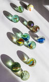 Roll over. Coloured and textured marbles in sunlight Royalty Free Stock Image