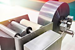 Roll of packaging film on machine food factory stock images