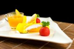 Roll pancake mango with mango juice on black background Royalty Free Stock Image
