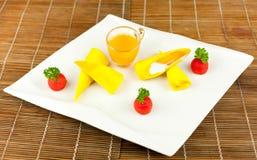 Roll pancake mango with mango juice on black background Stock Image