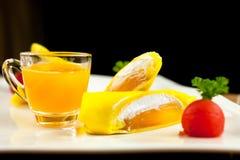 Roll pancake mango with mango juice on black background Stock Images