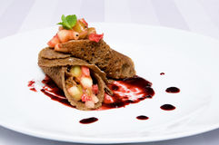 Roll pancakes with fruit Stock Photo