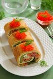 Roll pancakes with red fish Stock Photography