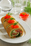 Roll pancakes with red fish Royalty Free Stock Photography