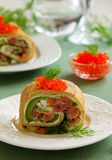 Roll pancakes with red fish Royalty Free Stock Photo