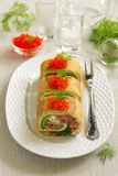 Roll pancakes with red fish Royalty Free Stock Photos
