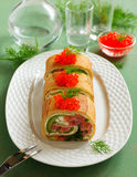 Roll pancakes with red fish Stock Images