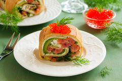 Roll pancakes with red fish Royalty Free Stock Images