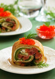 Roll pancakes with red fish Royalty Free Stock Image