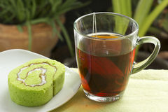 Roll pandan cake and hot tea Royalty Free Stock Photos