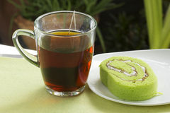 Roll pandan cake and hot tea Stock Photo