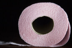 Roll of paper. End of a roll of paper towel or toilet paper.  Black background Stock Photos