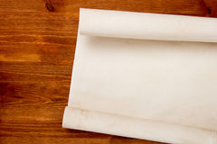 Roll of paper drawings. Roll of paper for drawings on a wooden table stock photo