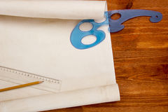 Roll of paper drawings. Roll of paper for drawings on a wooden table stock images