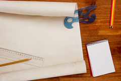 Roll of paper drawings. Roll of paper for drawings on a wooden table stock photography