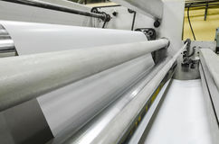 Roll of paper goes fast among rollers. Print machine, roll of paper goes fast among rollers Royalty Free Stock Photos