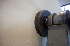 Roll of paper on paper mill. Roll of paper on pulp and paper mill royalty free stock photo