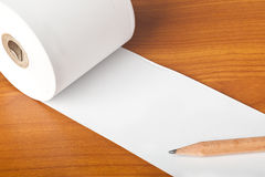 Roll of paper and pencil Stock Image