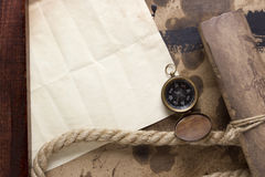 Roll of parchment with a compass royalty free stock photography