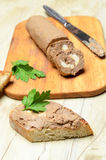 Roll pate and slices of toasted bread Stock Image