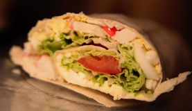 Roll of pita with lettuce,eggs and tomatoes stock photos