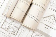 Roll of plans. Plans for house construction Stock Images