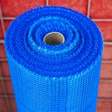Roll of plastic mesh on red background Stock Photo