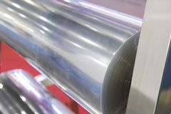 A roll of plastic sheet stock image