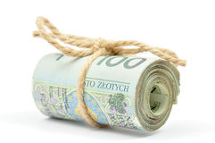 Roll of 100 PLN notes tied with a string. Roll of Polish 100 zloty (PLN) banknotes tied with a burlap string on white background royalty free stock photos