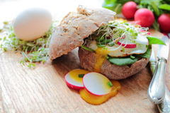 Roll with poached eggs and vegetables Royalty Free Stock Image