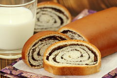 Roll with poppy seeds and milk Royalty Free Stock Photos