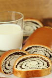 Roll with poppy seeds and milk Royalty Free Stock Photo