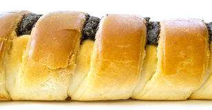 Roll with poppy seeds. On a white background Stock Photos