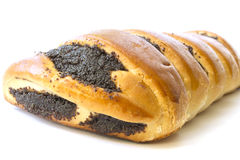 Roll with poppy seeds. On a white background Royalty Free Stock Images