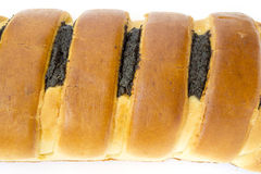 Roll with poppy seeds. On a white background Stock Photo