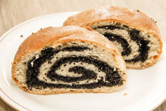 Roll with poppy seeds. Royalty Free Stock Photography
