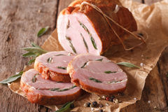 Roll pork stuffed with sage close up on the table. horizontal Royalty Free Stock Images