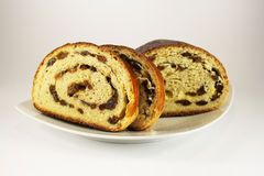Roll with raisins. Sliced loaf on a plate Royalty Free Stock Images