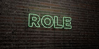 ROLL - realistiskt neontecken på bakgrund för tegelstenvägg - 3D framförd fri materielbild för royalty Royaltyfria Foton
