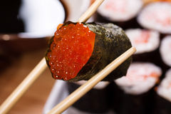 Roll with red caviar Stock Images