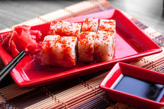 Roll with red caviar on top Royalty Free Stock Image
