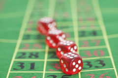 Roll of the red dice on a game table Royalty Free Stock Image
