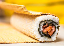 Roll with red fish and sesame seeds Stock Photos