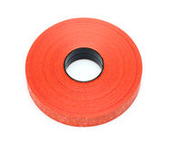 Roll red plastic ribbon Stock Photos
