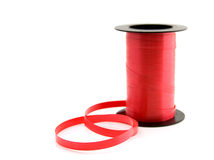 Roll of red ribbon Stock Photo